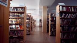 Camera running through library