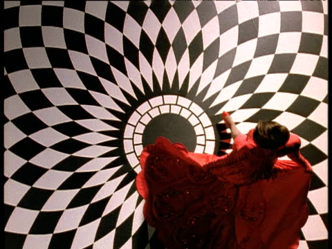 camera spins as woman in red dress walks on black and white tiled floor then looks at herself in the mirror - red dress stock videos & royalty-free footage