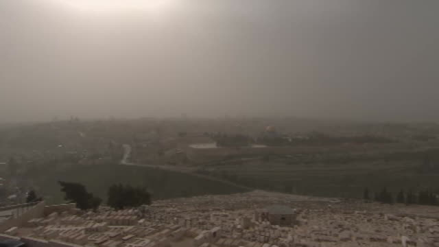 camera tilt establishing shot of the skyline in jerusalem, israel on a cloudy day. - religion or spirituality stock videos & royalty-free footage