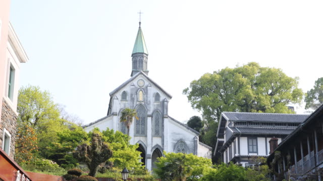a camera tilt up showing a stone staircase leading to the oura catholic church - キリスト教点の映像素材/bロール