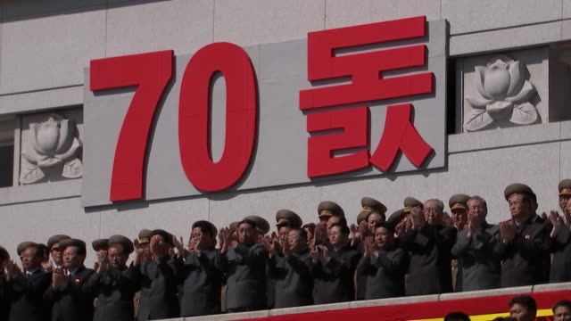 camera tilt up to a 70th anniversary sign at north koreaõs 70th anniversary military parade held on september 9, 2018 in pyongyang, north korea. - 70周年点の映像素材/bロール