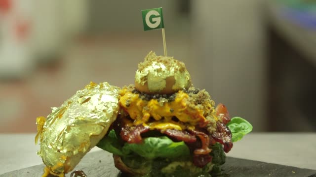 Camera tilts down to full shot of goldencrusted Glamburger in London UK on October 13 2014