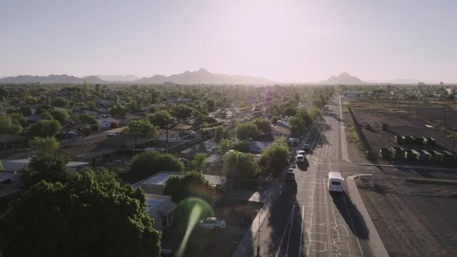 Camera tracks city street in residential neigborhood