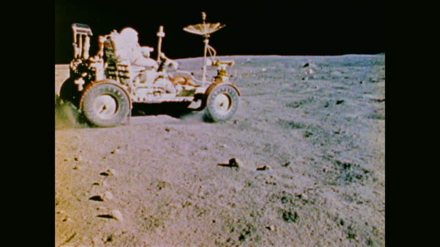 stockvideo's en b-roll-footage met camera tracks the path of the apollo lunar roving vehicle as its drives along the lunar surface - missiehuis