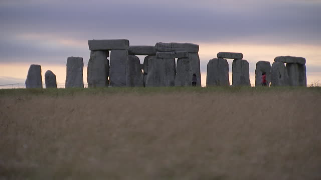 camera zoom on a wide angle shot of tourists at stonehenge on august 28, 2018 in wiltshire, england. - wide angle stock videos & royalty-free footage