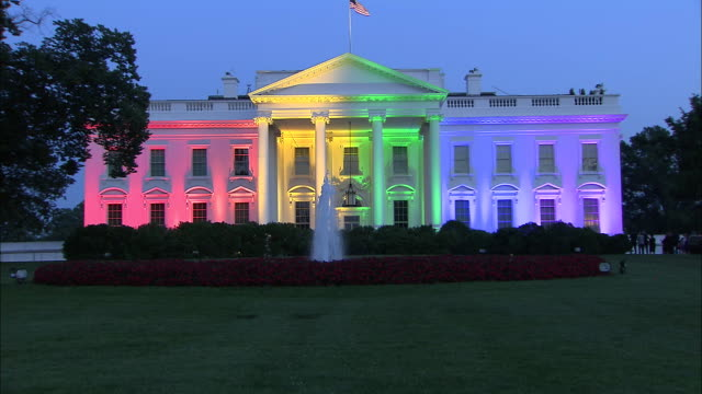 camera zoom out to a wide establishing shot of the white house exterior lit up in rainbow colors after the supreme courtõs decision to legalize... - 2015 stock videos & royalty-free footage