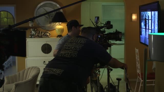 vídeos de stock e filmes b-roll de cameraman and dolly grip working on shooting an interior scene at now apocalypse on set visit behind the scenes on july 25 2018 in los angeles... - montagem de filme estúdio de cinema