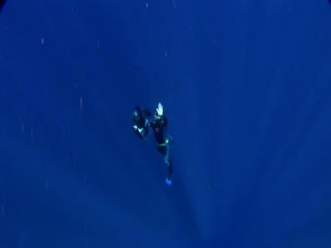 Cameraman ascending, exit frame, Toku, Tonga