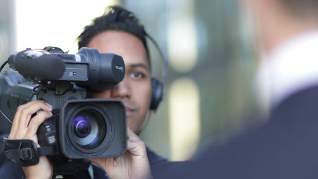 cameraman filming for media broadcasting - report stock videos & royalty-free footage