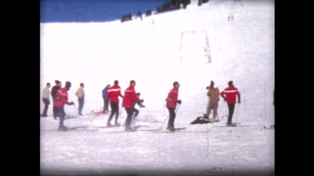 1967 cameraman filming skiers in Champery with camera on tripod