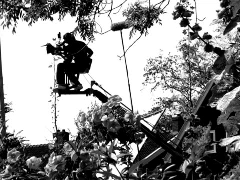 cameraman filming (black and white)