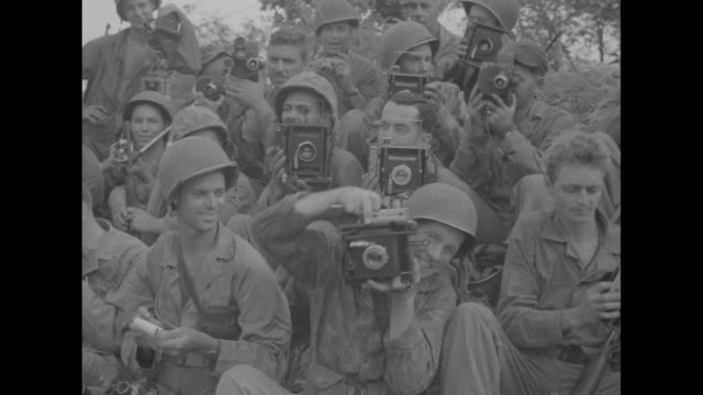 cameraman holding camera / group of us marines resting / marines resting cameramen in group holding cameras / officer sitting on table outside... - guam stock videos and b-roll footage