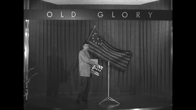 """vidéos et rushes de cameraman leaves tom morrow, james o'neil of the american legion, and vp richard nixon in front of american flag on curtained wall under sign, """"old... - clap de cinéma"""