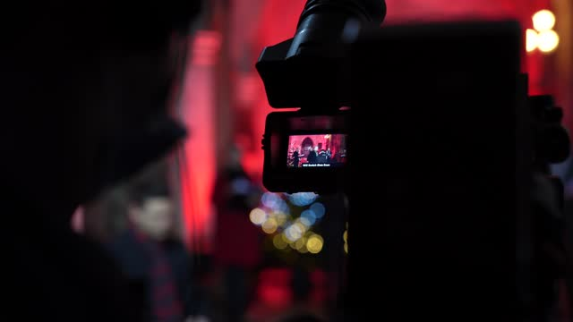 cameraman monitors the camera as performance resets behind the scenes at westminster abbey on december 21, 2020 in london, england. out to perform... - レスリー ギャレット点の映像素材/bロール