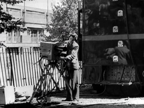 cameraman prepares a television camera for the bbc broadcast of the 1948 london olympic games england. - bbc stock videos & royalty-free footage