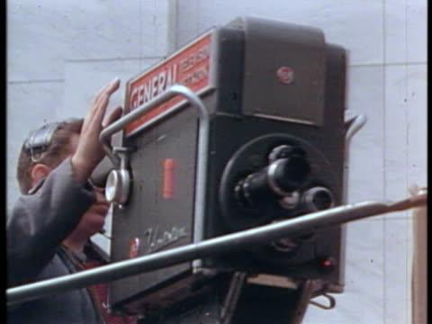 CU PAN TU TD WS Cameraman taking scene at film shooting / USA.
