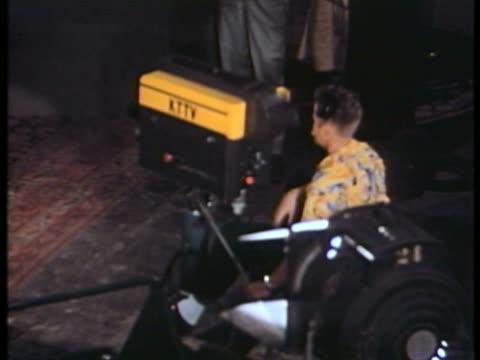 MS WS TD Cameraman taking scene at film shooting / USA.