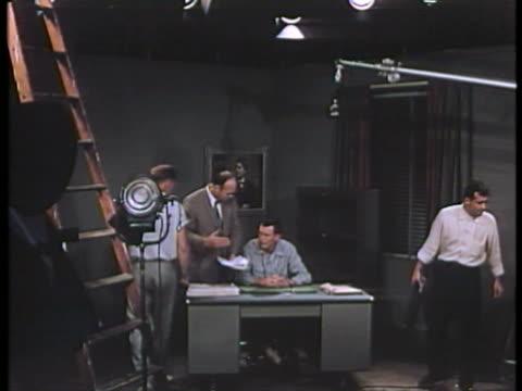 WS Cameraman taking scene at film shooting / USA.