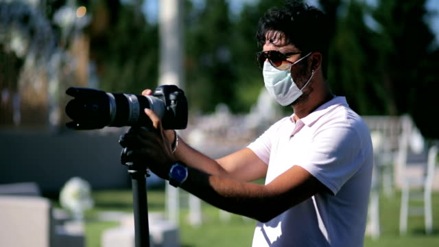 cameraman wearing protective face mask during covid19 - photographer stock videos & royalty-free footage