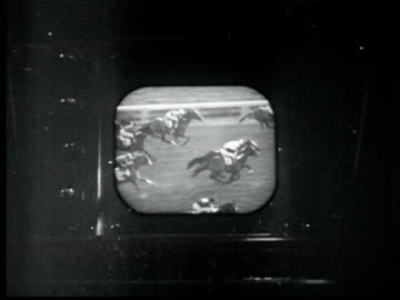 1945 b/w montage cameramen film start of horse race. two men watch race on tv at home. mayor laguardia throws out baseball. nbc camera on tripod. red ruffing bats. madison square garden. golden gloves boxing. congress clapping / new york city / audio - film montage stock videos & royalty-free footage