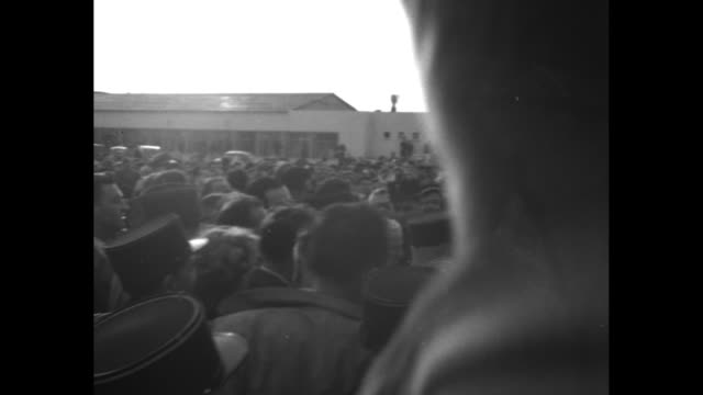 cameramen stand on the roof of orly airport / gendarmes in crowd / vs chaplin in middle of crowd as flashbulbs go off / jostled camera shots of... - 1952 stock videos & royalty-free footage