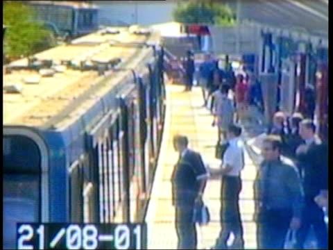 cameras cctv passengers on train station platform int cctv seq hat robber - criminal stock videos & royalty-free footage