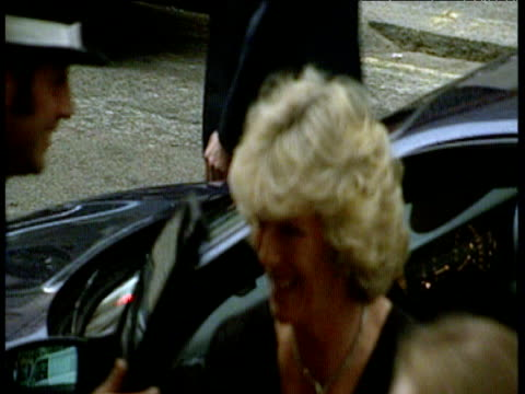 cameras flash as camilla parkerbowles steps out of car at the ritz hotel 10 may 00 - bbc点の映像素材/bロール