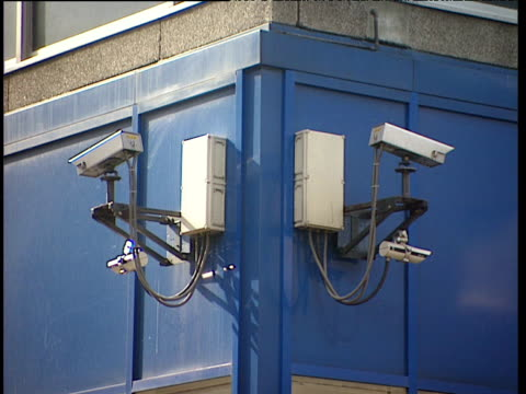 cctv cameras on corner of building - television camera stock videos and b-roll footage