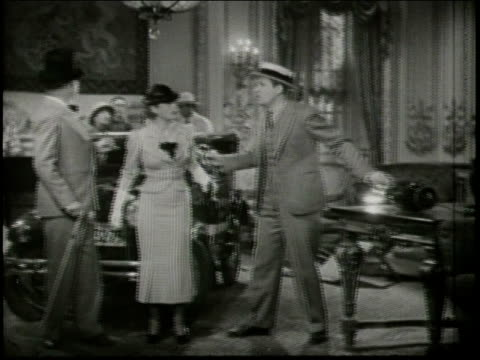 Cameras roll as WC Fields acts out a conversation with a fellow actor / The earth begins to shake suddenly surprising everyone and knocking over a...