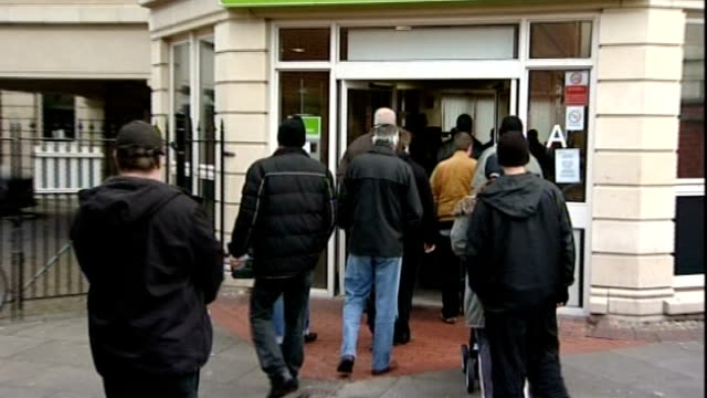 cameron announces plans for new welfare crackdown england ext various of people entering job centre plus offices job seeker using touch screen... - soziale fürsorge stock-videos und b-roll-filmmaterial