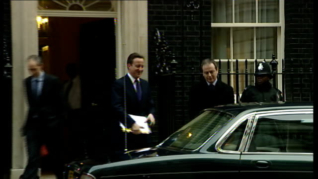 ext cameron departing number 10 downing street along and into car - 10 downing street stock videos and b-roll footage