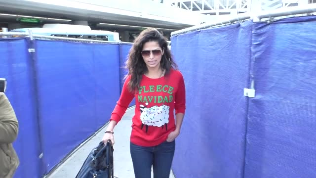 Camila Alves wearing Christmas sweater arriving at LAX Airport in Los Angeles in Celebrity Sightings in Los Angeles