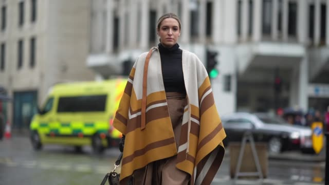 camila carril wears a black turtleneck pullover a brown skirt a white brown and orange poncho plaid / cape a fendi monogram bag during london fashion... - brown stock videos & royalty-free footage