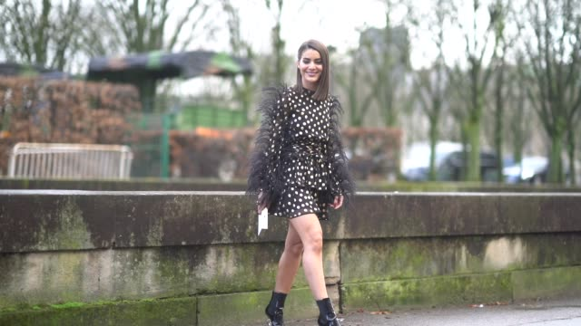 camila coelho wears a black dress with printed polka dots, fur, outside valentino, during paris fashion week womenswear fall/winter 2018/2019, on... - black dress stock videos & royalty-free footage