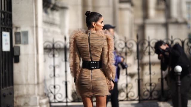 camila coelho wears a brown lace dress with ruffles a large belt outside balmain during paris fashion week womenswear spring/summer 2019 on september... - spring summer collection stock videos & royalty-free footage