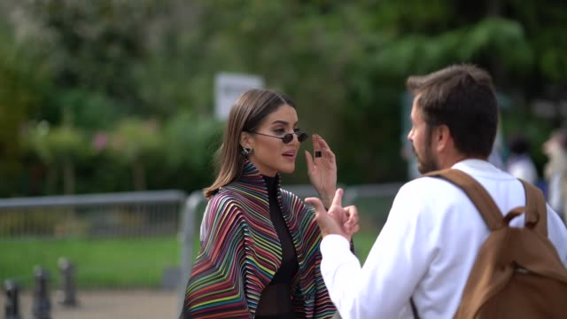 camila coelho wears a colored jacket, a mesh top, black pants, a pink bag, outside issey miyake, during paris fashion week womenswear spring/summer... - mesh textile stock videos & royalty-free footage