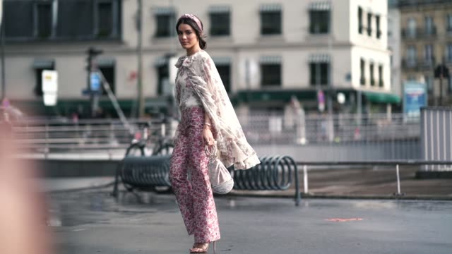camila coelho wears a headband a ruffled lace floral print top pink floral print pants a bag outside giambattista valli during paris fashion week... - floral pattern stock videos & royalty-free footage