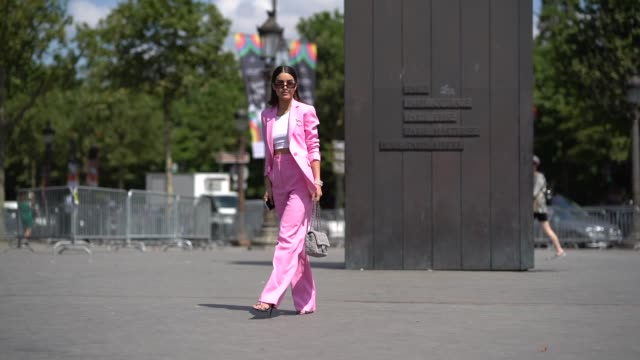 camila coelho wears a pink blazer jacket pink flared pants a chanel bag a white cropped top outside chanel during paris fashion week haute couture... - blazer jacket stock videos & royalty-free footage