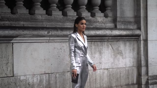 Camila Coelho wears a silver glitter blazer jacket outside Balmain during Paris Fashion Week Womenswear Fall/Winter 2018/2019 on March 2 2018 in...