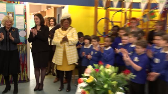 camilla at barn croft primary school for commonwealth big lunch; camilla, duchess of cornwall into room and presented with book and cake / camilla... - signierstunde stock-videos und b-roll-filmmaterial