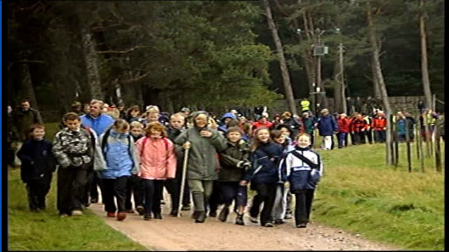 camilla, duchess of rothesay, undertakes 10-mile walk for osteoporosis sufferers; various of camilla walking with schoolchildren at front of group... - osteoporosis stock videos & royalty-free footage