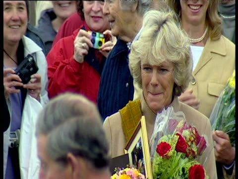 camilla parker-bowles clutches flowers surrounded by well wishers leaving church people take photos of her and prince charles; aug 02 - number of people stock videos & royalty-free footage