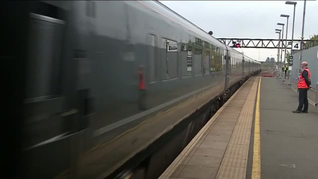 stockvideo's en b-roll-footage met camilla unveils plaque at swindon railway station england wiltshire swindon ext workers preparing plauqe for sir daniel gooch place / train pulls in... - wiltshire