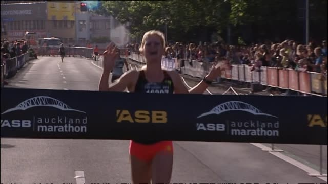 camille buscomb winning the women's auckland half marathon - 2014 stock videos & royalty-free footage