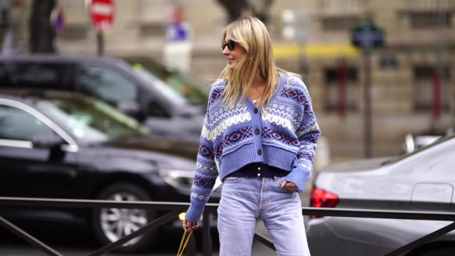 camille charriere wears a blue and white striped wool jacket, blue denim jeans, white shoes, a blue bag, outside miu miu, during paris fashion week... - jeans stock videos & royalty-free footage