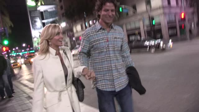camille grammer & dimitri charalambopoulos leaving the pantages theater in hollywood 03/20/12 camille grammer & dimitri charalambopoulos leaving on... - pantages theater stock videos & royalty-free footage