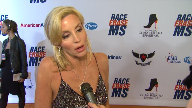 camille grammer on being a part of the night her glam rock attire her advice for those walking in the show at 19th annual race to erase ms glam rock... - race to erase ms stock videos and b-roll footage
