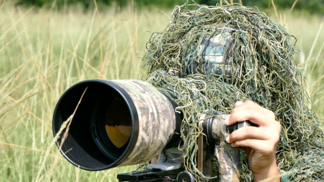 camouflage photographer in the ghillie suit - disguise stock videos and b-roll footage