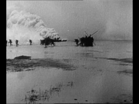 camouflaged artillery guns fire / japanese troops arrive on chinese shore, advance as ship burns in background / japanese soldiers run on shore /... - britisches militär stock-videos und b-roll-filmmaterial