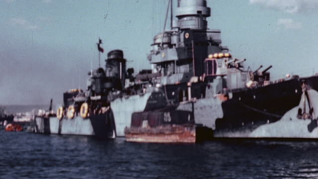 camouflaged italian navy cruiser anchored in harbor after the 1943 armistice / taranto italy - anchored stock videos & royalty-free footage